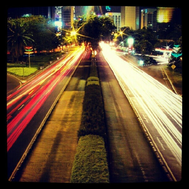 I took this photo when i first experimented low speed photography. Taken with a kodak semipro at semanggi-jakarta.