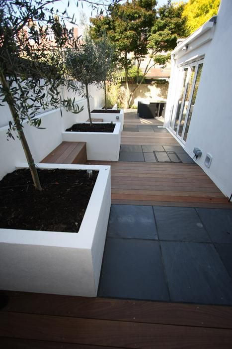 Individual beds for small trees. Would make less modern, more traditional for our old tudor