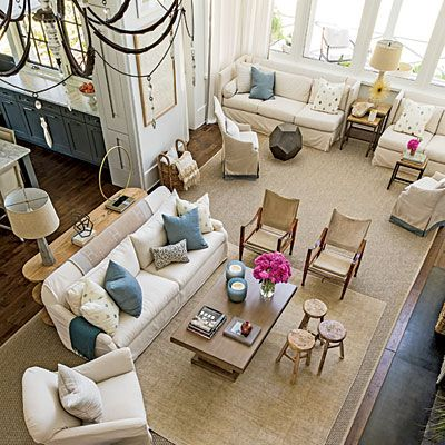 "Living Room: The Space | ""The stunning views of the marshland drove the living room design,"" says architect Ken Pursley. He also wanted the room to be large enough for a family to be simultaneously connected and separate in two seating areas."