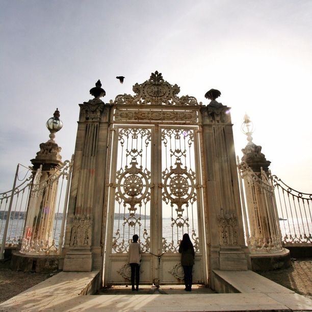 Dolmabache Palace, Istanbul, Turkey — by Bernini. Looking out from the Dolmabache Palace gates to the Bosphorus strait. Felt like we were looking inside Heaven's gates!