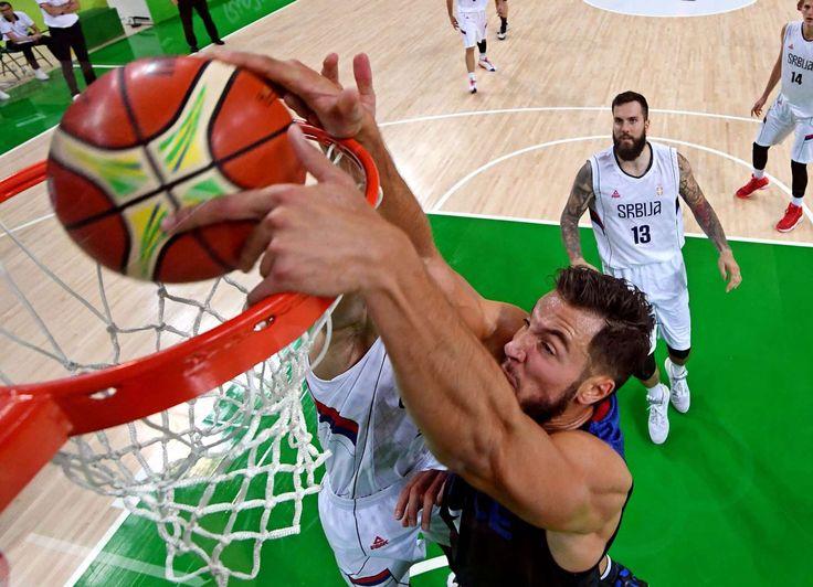 Serbia center Nikola Jokic (14) dunks the ball against Serbia small forward Marko Simonovic (5) during men's basketball preliminary round in the Rio 2016 Summer Olympic Games at Carioca Arena 1.