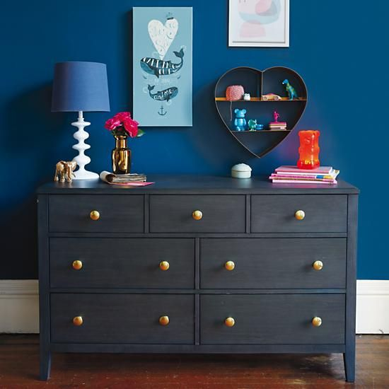 Land of Nod. Dark dresser with gold knobs.
