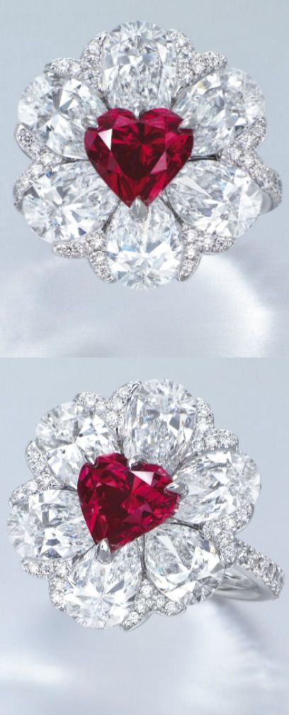A STUNNING COLOURED DIAMOND AND DIAMOND RING, BY MOUSSAIEFF DESIGNED AS A FLOWERHEAD, SET WITH A HEART-SHAPED FANCY RED DIAMOND WEIGHING APPROXIMATELY 2.09 CARATS, WITHIN A PETAL SURROUND SET WITH SIX PEAR-SHAPED DIAMONDS WEIGHING APPROXIMATELY 1.07 TO 1.01 CARATS, ACCENTED BY BRILLIANT-CUT DIAMONDS, TO THE SIMILARLY-CUT DIAMOND THREE QUARTER-HOOP, MOUNTED IN 18K WHITE GOLD,