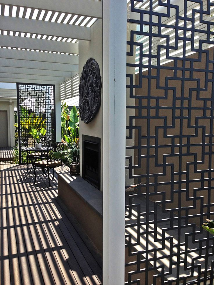 QAQ's beautiful 'Tokyo' decorative screens enclose the sides of this lovely patio.