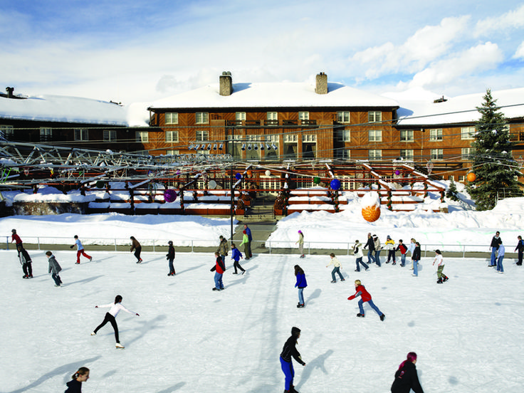 Visit the iconic Sun Valley outdoor ice skating rink, a great family activity.