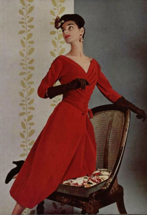 Model wearing a red velour dress by Jacques Fath, 1955.