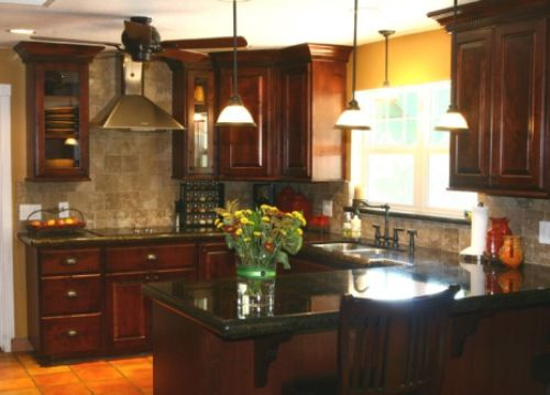 kitchen color schemes with dark wood cabinets 16 best images about cabinets with uba tuba granite on 21526
