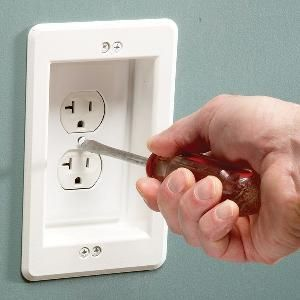 Install a Wall Hugger Receptacle. The plug will not stick out so you can scoot your furniture close to the wall!
