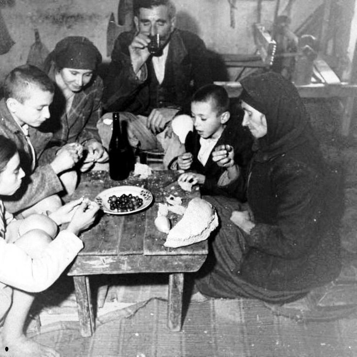 the history of bread in Greece... Here a family eating bread and olives for supper
