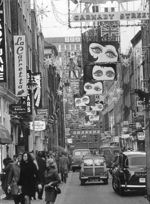 London's Carnaby Street gets in the festive spirit (1964)  (is this 1964 I wonder??)