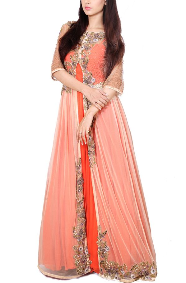 Featuring Tangerine orange floor lenght panelled flare suit with can can finish. sheer beige net jacket layered on top. full pearl highlight yoke with stylized leather placement embroidery all over the jacket. #jacketgowns #bridesmaid #indowestern