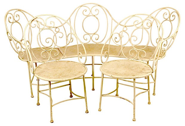 French wrought-iron suite consisting of one curved settee and two arm chairs, circa 1900.