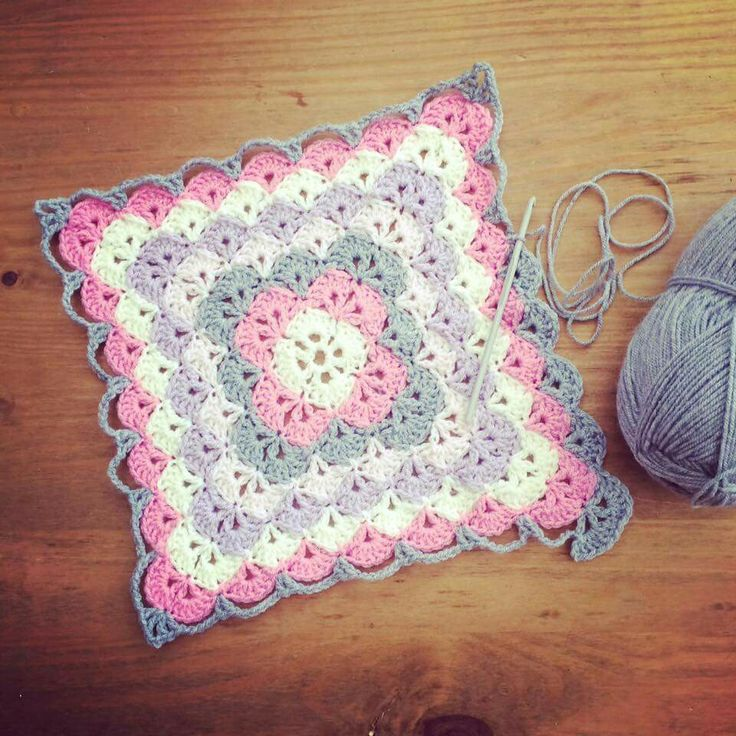 Screen shot from Facebook of a shell stitch granny square, would make a beautiful baby blanket.