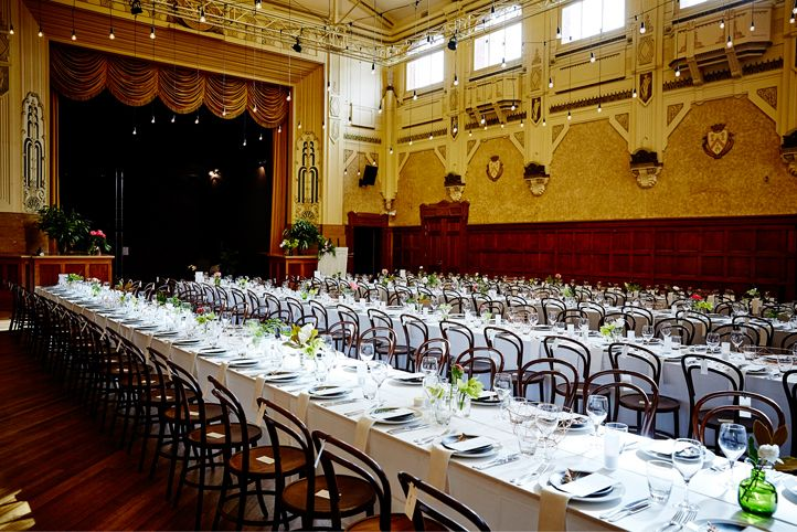 LETTUCE & CO - STYLE. EAT. PLAY 'viv + lachy - modern art deco'. town hall transformaiton. 4 long banquet tables. bentwood chairs. linen weave tablecloths. hanging installation. giant paper flowers. paper magnolia. wedding reception @ northcote town hall. concept, design and wedding styling by lettuce & co