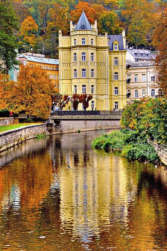 Karlovy Vary - Czech Republic.. One of the most beautiful cities I've ever been too and I remember saying that I wanted to live in this yellow building!