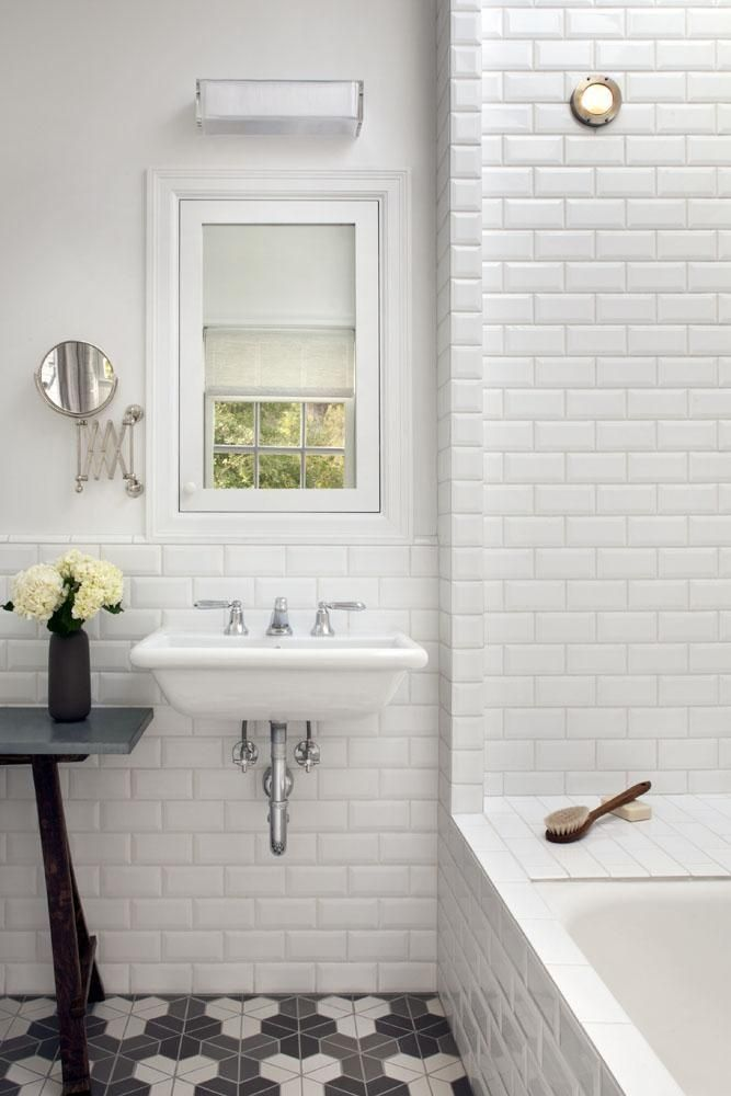 Image Gallery For Website White Beveled Subway Tile Bathroom With Graphic Hex Tile Flooring And Wall Mounted Sink And Small Window Subway Tile Bathroom Walls In Bathroom Category