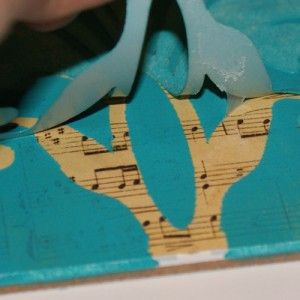 Stencil over sheet music, love. Fun idea for over the piano!