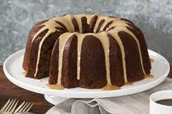 CHOCOLATE - KAHLUA CAKE	  1 box chocolate cake mix 1/2 c. vegetable oil 1 pkg. (6 oz.) instant chocolate pudding mix 4 eggs 3/4 c. Kahlua liqueur 1/2 c. water 6 tbsp. Kahlua liqueur 1 c. confectioners' sugar, sifted Preheat oven to 350 degrees. Combine first 6 ingredients in mixing bowl and blend well. Pour into greased and lightly floured 9 1/2 inch Bundt pan. Bake 45-50 minutes or until cake springs back when lightly touched. Combine 6 tablespoons Kahlua and confectioners' sugar. While…