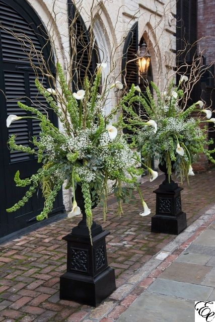 Black Charleston Urn Altar Arrangements   William Aiken House   Gold Curly Willow   Bells of Ireland   White Calla Lilies   Baby's Breathe   Green and Black Wedding   Designed by Engaging Events