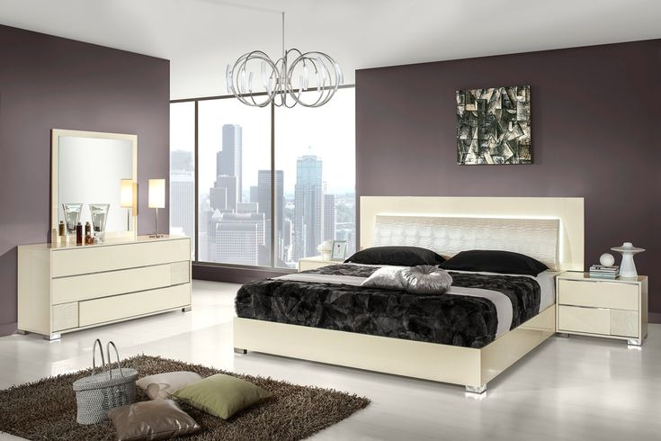 Italian bedroom set with LED light around the headboard. The lovely bed is part of our new collection of stunning modern bedroom furniture from Italy. The crocodile padded headboard with built in lights around it, and its soft smooth lines suit modern or slightly more traditional environments. Comes...