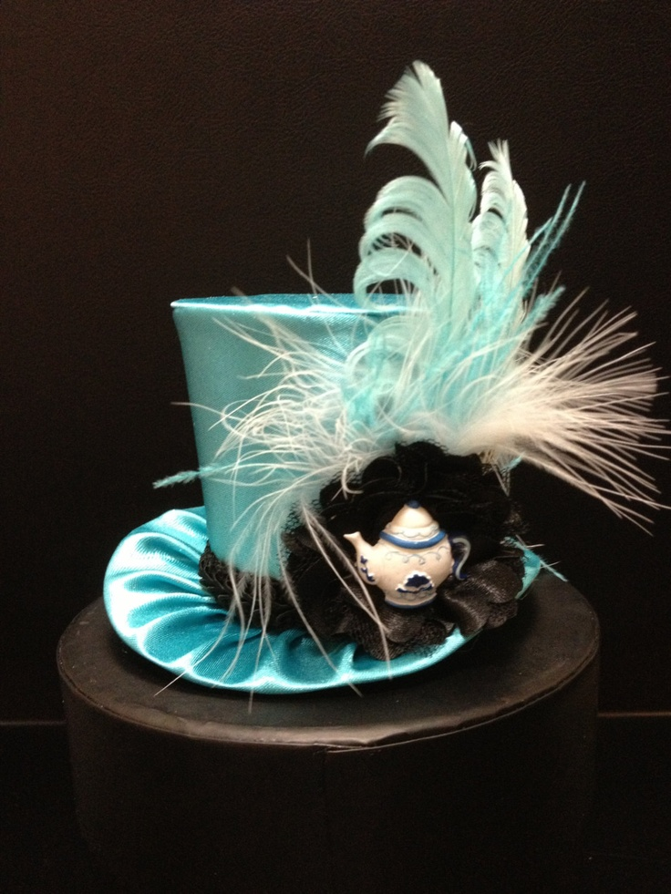 Alice in Wonderland Inspired  Mini Top Hat for Dress Up, Birthday, Tea Party or Photo Prop. $29.95, via Etsy.