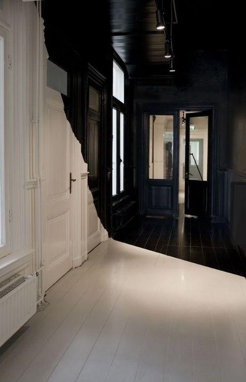 paint it out - graphic colour split - black and white hallway