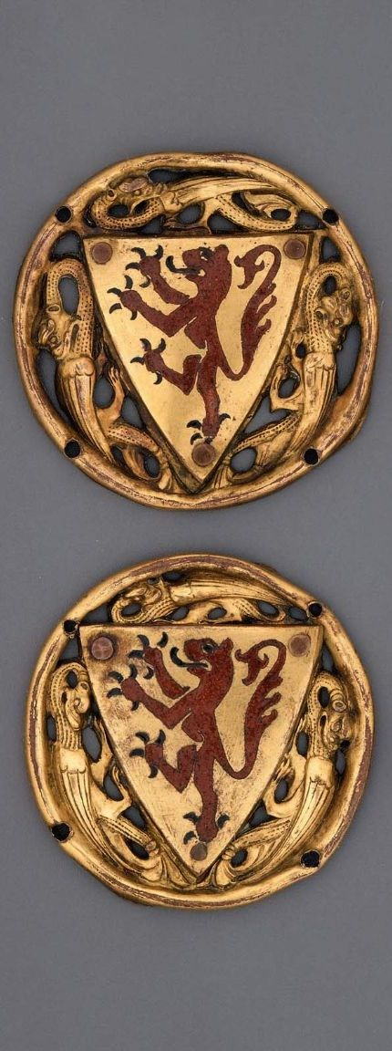 Heraldic Roundel, French (Limoges), Medieval, third quarter of 13th century -- Three ajoure modeled dragons fill spaces in circle (four holes for fastening) left by shield of red rampant lion of Leon with black claws.