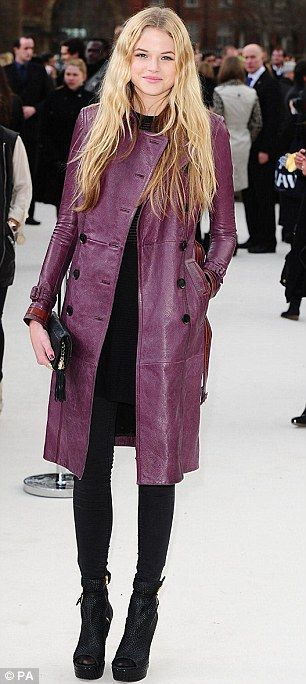 On trend: Italian TV personality Giorgia Surina wore yet another trench coat, as did model Gabriella Wilde, bust she opted for a retro purple design