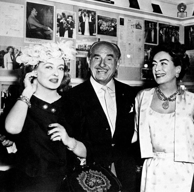 The King and his 2 queens - Bette Davis Jack Warner (Prez of Warner Bros Pictures) and Joan Crawford! -- I tell ya, when I saw any of these 3 at that studio, I looked for the closest rock to crawl under!!  The earth really did quake when any of them walked by!
