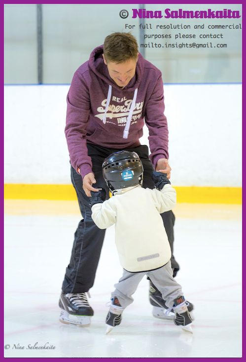 Most figure skaters start at a skating school. Here is a father with his son.