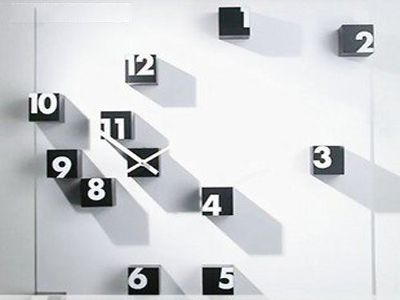creative clock design of scattered pieces of numbered cubes on a wall creative blocks of time