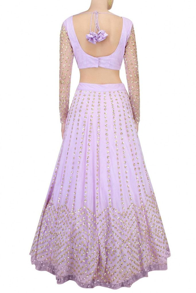 This set features a lavender lehenga in net base appliqued with small sequin flowers all over front and back. It has a can-can underlayer. It comes along with a matching lavender blouse with sequins f