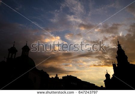 """Main Square in Krakow, Poland, during sunset"""