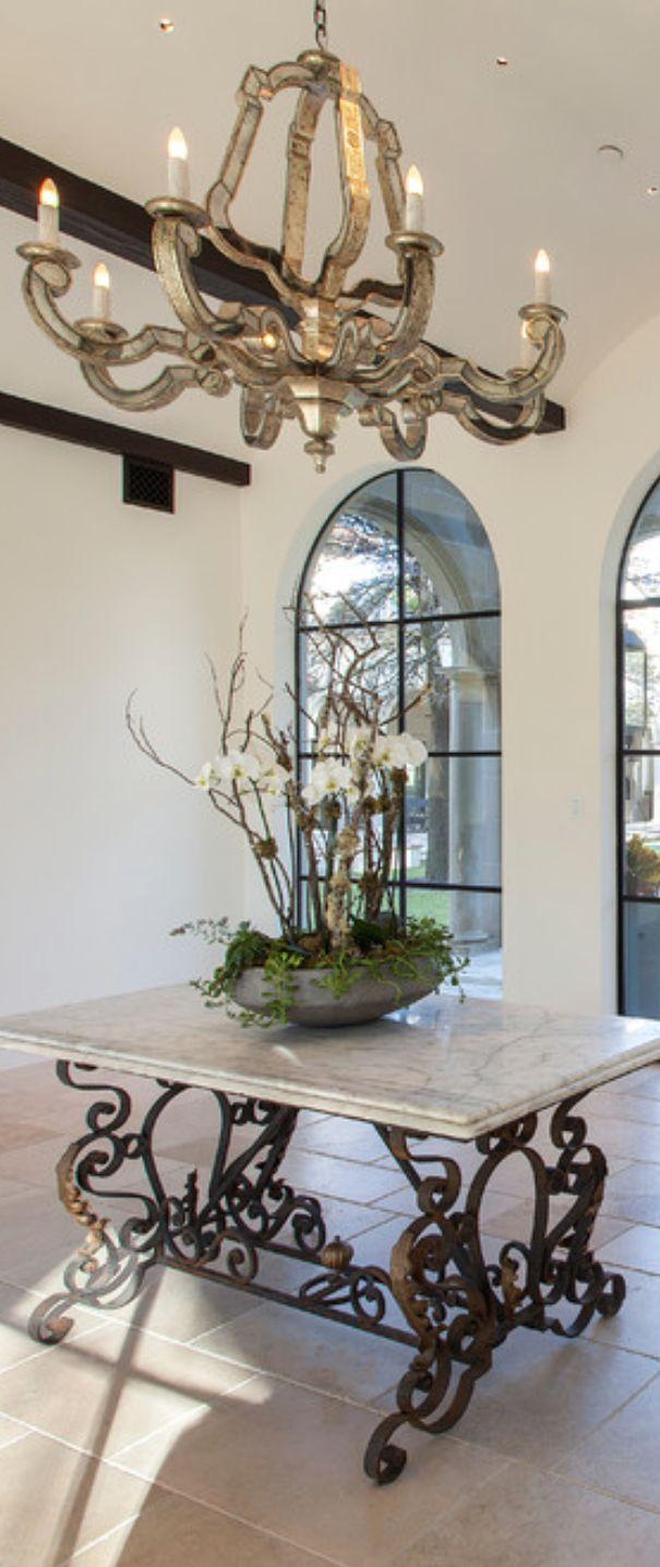 mediterranean tuscan entry gorgeous chandelier iron windows