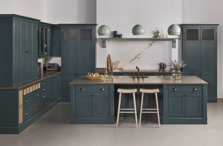 Introducing Arbor, our new and exclusive kitchen range. Painted in Farrow & Ball 'Inchyra Blue' with walnut internal detailing.