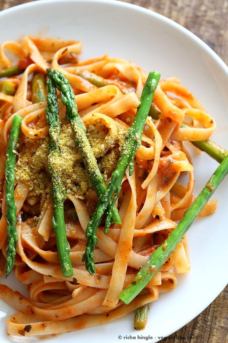 Fettuccine with Tomato Cream Sauce and Asparagus. Easy tomato Cream sauce with pasta and garlic roasted Asparagus. Use other veggies of choice. Add some chickpea chorizo or smoked coconut for variation. Vegan Soyfree Recipe. Can be gluten-free with gf pasta.   VeganRicha.com