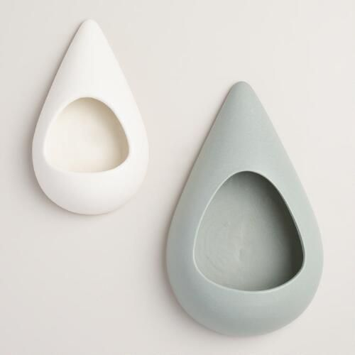 Our teardrop-shaped ceramic planter showcases your air plants for a new twist on wall art. In small and large sizes, they look stunning arranged in multiples and make a fresh and affordable update to your home decor.