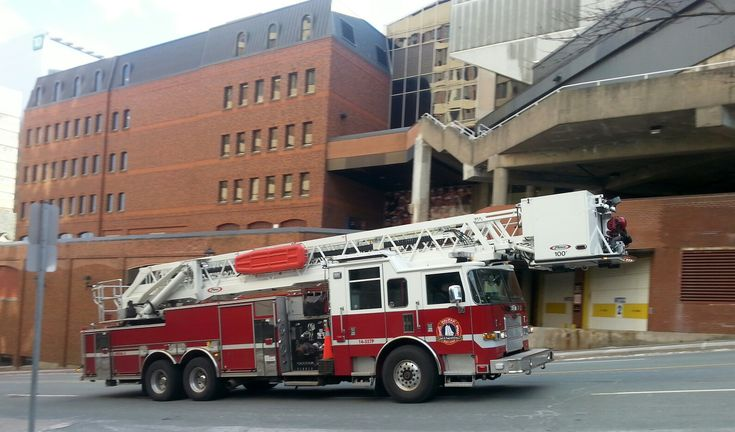 Halifax Regional Municipality Fire Aerial 3 (14 557P 2014 Pierce Arrow XT) returning to its station on a frigid December 27th, 2017 afternoon. Shortly before I had seen Engine 3 responding to a call in downtown Halifax and I expect this apparatus had responded to the same call. Thankfully the brave men and women of Halifax Fire were able to return to the warmth of their stations as this was no day to be outside, let alone outside fighting a fire. #HalifaxAuthor #Halifax #hrmfire #halifaxfire