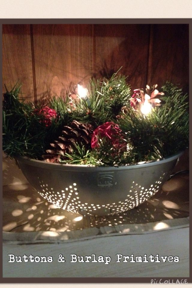 Using a vintage star cut out colander, some rustic decor and Christmas greens, and of course lights I made this beautiful piece. Check out all my creations at https://www.facebook.com/pages/Buttons-Burlap-Primitives/691971410876283