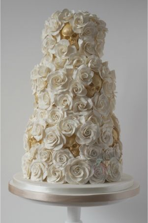 white and gold hidden skulls wedding cake