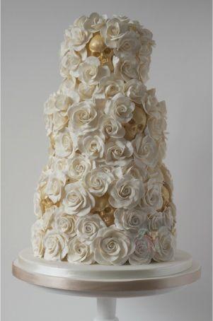 white and gold hidden skulls wedding cake
