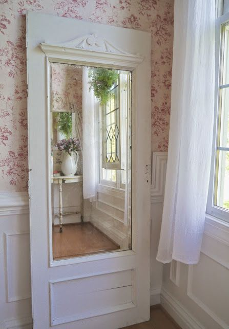 Old painted white door with a mirror added. Would look wonderful in any room of your home! Vintage Farmhouse