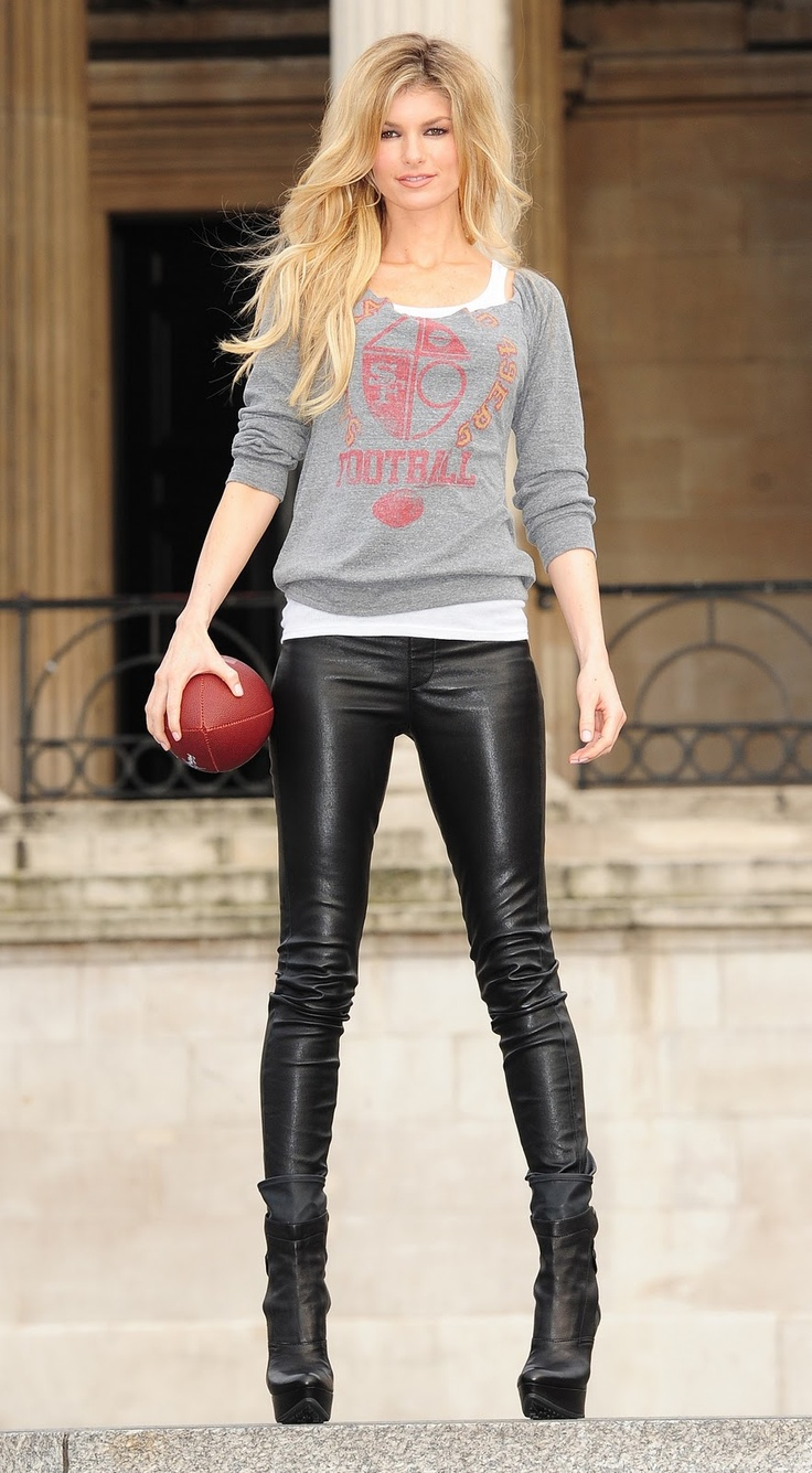 Marisa Miller is casual glam in leather pants and a comfy off the shoulder graphic sweater