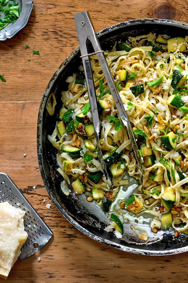 NYT Cooking: Summer's first, glossy zucchini from the farm stand are to be treasured. Here they are diced, sautéed until tender, bolstered with garlic, pine nuts and Grana Padano, and mingled with fresh pasta.