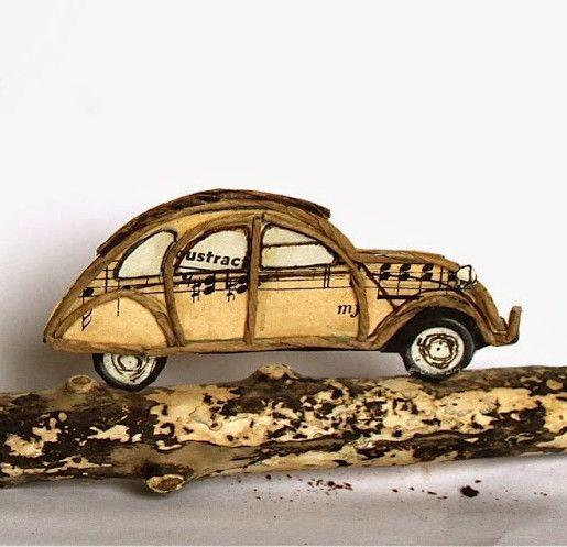 Thème voyage : voiture en découpe de papier collée sous du kraft armé - création…