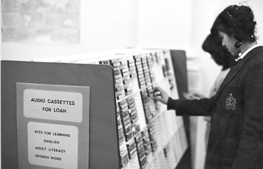 Selecting audio cassettes at the library, ca. 1984.