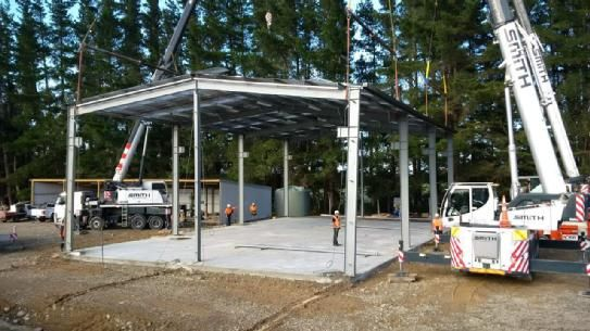 Structural steel workshop for a logging contractor in North Canterbury, NZ. The building was designed for the owner to fit a gantry crane in the future.