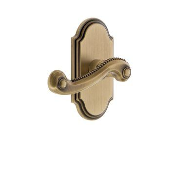 Grandeur Newport Door Lever with Arc Plate Finish: Vintage Brass Lever Orientation: Right
