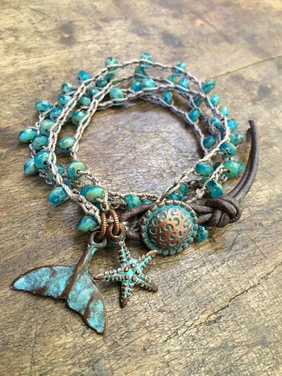 Beautiful mixed turquoise Czech beads are crocheted onto nylon cord featuring a beautiful patinied whale tail & starfish. Stunning contrast!
