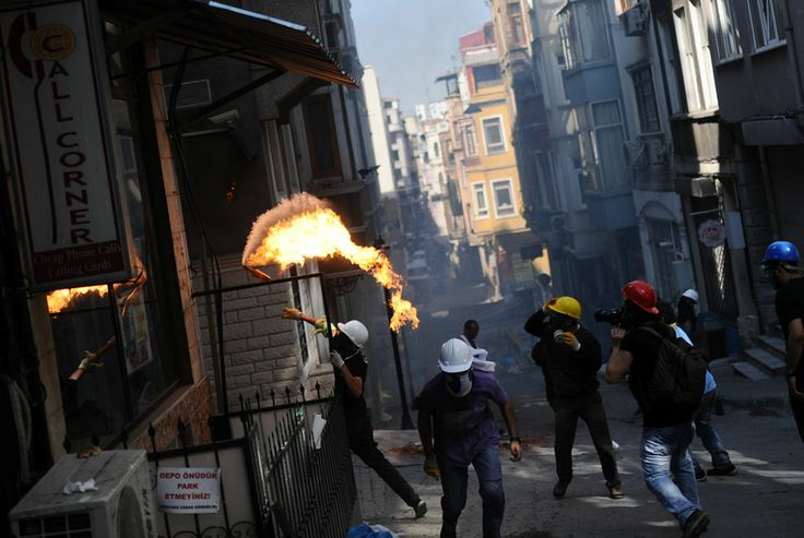 A demonstrator throws a molotov cocktail near Taksim Square, early on June 11, 2013